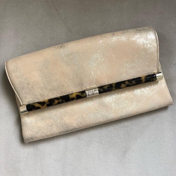Diane Von Furstenberg Handbags - NWOT DVF Clutch Diane von Furstenburg Gold Bag